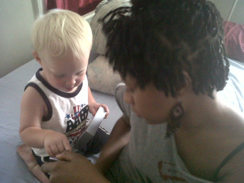 Me with my nephew and my hair (major shrinkage).